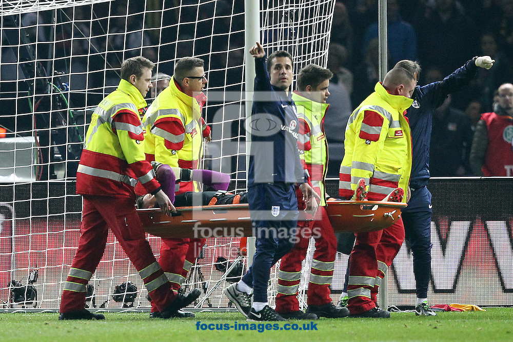 Jack Butland of England is injured and has to leave the match on a stretcher during the International Friendly match at Olympiastadion Berlin, Charlottenburg-Wilmersdo<br /> Picture by Paul Chesterton/Focus Images Ltd +44 7904 640267<br /> 26/03/2016