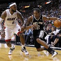 17 January 2012: San Antonio Spurs small forward Kawhi Leonard (2) drives past Miami Heat small forward LeBron James (6) during the Miami Heat 120-98 victory over the San Antonio Spurs at the AmericanAirlines Arena, Miami, Florida, USA.