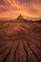 A stunning sunset over the cracked mud badlands of the Colorado Plateau, Utah, USA.