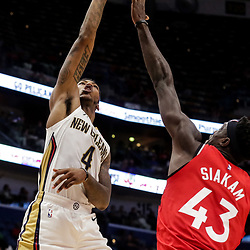 Oct 11, 2018; New Orleans, LA, USA; New Orleans Pelicans guard Elfrid Payton (4) shoots over Toronto Raptors forward Pascal Siakam (43) during the first half at the Smoothie King Center. Mandatory Credit: Derick E. Hingle-USA TODAY Sports
