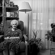 Residents of Sunrise Park, assisted living center pose for portraits in their rooms and watch TV in the main area and eat lunch at the main table in Lewiston, Utah, Saturday June 16, 2012. (August Miller)