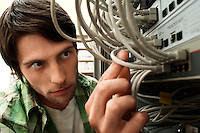 Man working on network switch close-up.