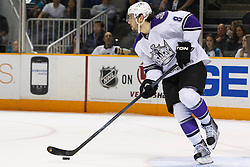 April 4, 2011; San Jose, CA, USA;  Los Angeles Kings defenseman Drew Doughty (8) skates with the puck against the San Jose Sharks during the first period at HP Pavilion. San Jose defeated Los Angeles 6-1. Mandatory Credit: Jason O. Watson / US PRESSWIRE
