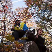NYTRUN - NOV. 6, 2016 - NEW YORK - Perched atop the sculpture on Cat Hill, cameraperson Mark Wiitanen films while Dan Levinsohn cheers on runners in the 2016 TCS New York City Marathon, in Central Park on Sunday afternoon. NYTCREDIT:  Karsten Moran for The New York Times