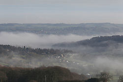© Licensed to London News Pictures. 06/02/2017. Huddersfield, UK. Thick banks of fog cover Huddersfield on a cold February morning in West Yorkshire. Forecaster are predicting heavy rain this week but none was in sight here as the sun began to shine and burn through the dense fog. Photo credit : Ian Hinchliffe/LNP