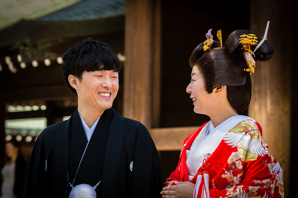 Meiji shrine, in Harajuku, is a favorite spot for traditional japanese weddings, especially in sundays. Here, a happy couple in traditional wedding clothes poses for the portrait