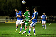 Lee Vaughan (Tranmere Rovers) and Jake Skelton (North Ferriby United) go to head the ball during the Vanarama National League match between North Ferriby United and Tranmere Rovers at Eon Visual Media Stadium, North Ferriby, United Kingdom on 21 March 2017. Photo by Mark P Doherty.