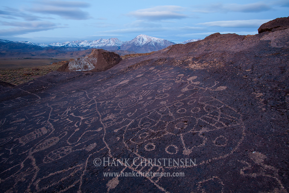 The Sky Rock Petroglyph outside of Bishop, CA begins to glow in pre-dawn light. Some have theorized that it was probably created by the ancestors of what are today known as the Owens Valley Paiute, possibly as long as 8,000 years ago.