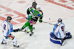 Brad Cole (HDD Tilia Olimpija, #2) vs Adam Munro (SAPA Fehervar AV19, #51) during ice-hockey match between HDD Tilia Olimpija and SAPA Fehervar AV19 at second match in Quarterfinal  of EBEL league, on Februar 21, 2012 at Hala Tivoli, Ljubljana, Slovenia. HDD Tilia Olimpija won 2:1 in OT. (Photo By Matic Klansek Velej / Sportida)