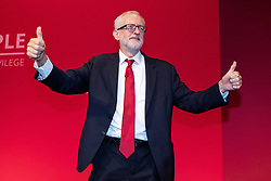 © Licensed to London News Pictures . 24/09/2019. Brighton, UK. Labour leader JEREMY CORBYN gives two thumbs up from the stage after delivering the leader's speech a day early , on the fourth day of the 2019 Labour Party Conference from the Brighton Centre , after the Supreme Court ruled that Boris Johnson's suspension of Parliament was unlawful . Photo credit: Joel Goodman/LNP