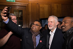 London, UK. 20th November, 2018. Leader of the Opposition Jeremy Corbyn has his photograph taken with an enthusiastic fan as he leaves a March for Education rally to protest against crises involving education funding, recruitment, staff retention and remuneration.