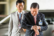 08 AUGUST 2014 - BANGKOK, THAILAND:         Air Chief Marshal ARKHOM KANCHANAHIRUN, a member of the Thai NLA, checks his watch while he walks into the first meeting Friday. The Thai National Legislative Assembly (NLA) met Friday at the Parlimanet Building in Bangkok to elect legislative leadership. The NLA was appointed by the Thai junta, formally called the National Council for Peace and Order (NCPO), and is supposed to guide Thailand back to civilian rule after a military coup overthrew the elected government in May. There are 197 members of the NLA. Membership is tilted towards military personnel. From the Royal Thai Army 40 members are Generals, 21 are Lt. Generals and 7 are Major Generals. From the Royal Thai Air Force 17 are Air Chief Marshals and 2 are Air Marshals. From the Royal Thai Navy, 14 are Admirals and 5 are Vice Admirals. There are also 6 Police Generals and 3 Police Lt. Generals. There are 187 men in the NLA and only 10 women.  PHOTO BY JACK KURTZ