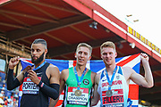 Bronze medalist Jake PORTER, gold medalist David KING and silver medalist Cameron FILLERY after the Men's 110m Hurdles Final during the Muller British Athletics Championships at Alexander Stadium, Birmingham, United Kingdom on 25 August 2019.