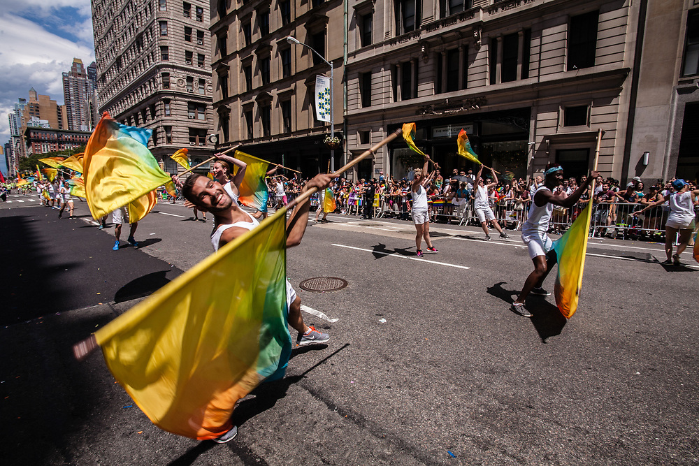New York, NY - 25 June 2017. New York City Heritage of Pride March filled Fifth Avenue for hours with groups from the LGBT community and it's supporters. Marchers twirl rainbow banners in a dance routine.