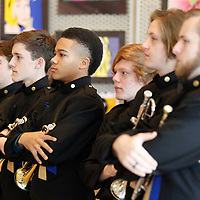 Thomas Wells | BUY AT PHOTOS.DJOURNAL.COM<br /> Marcus Davis, 17, center, listens as speakers remind members of the Tupelo High School Marching band that 20 years from now they will still talk about what they are about to experience when they attend the Presidental inauguration of Friday in Washington D.C.