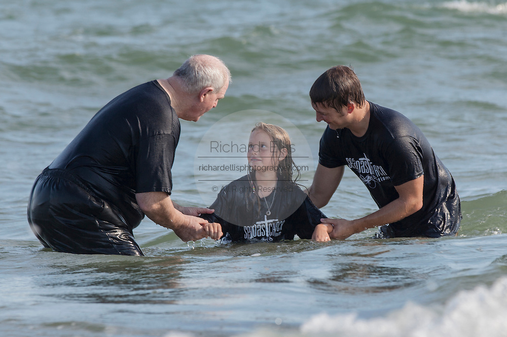 Members of the Christian Evangelical Seacoast Church perform baptism in the Atlantic Ocean September 11, 2011 on the Isle of Palms, South Carolina.