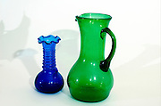 two vase of Hebron Glass one green one blue, Glassblowing in Hebron is a traditional industry