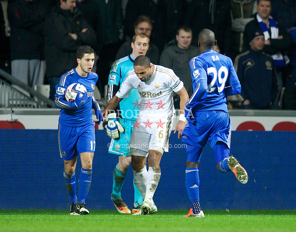 SWANSEA, WALES - Wednesday, January 23, 2013: Swansea City's captain Ashley Williams challenges Chelsea's Eden Hazard after he kicked out at a ball-boy during the Football League Cup Semi-Final 2nd Leg match at the Liberty Stadium. (Pic by David Rawcliffe/Propaganda)
