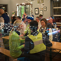 Members of the West Sixth Running Club enjoy some pretzels and beer during a Tuesday night gathering at West Sixth Brewing in Lexington, Ky., Tuesday, December 15, 2015. (Photo by David Stephenson)
