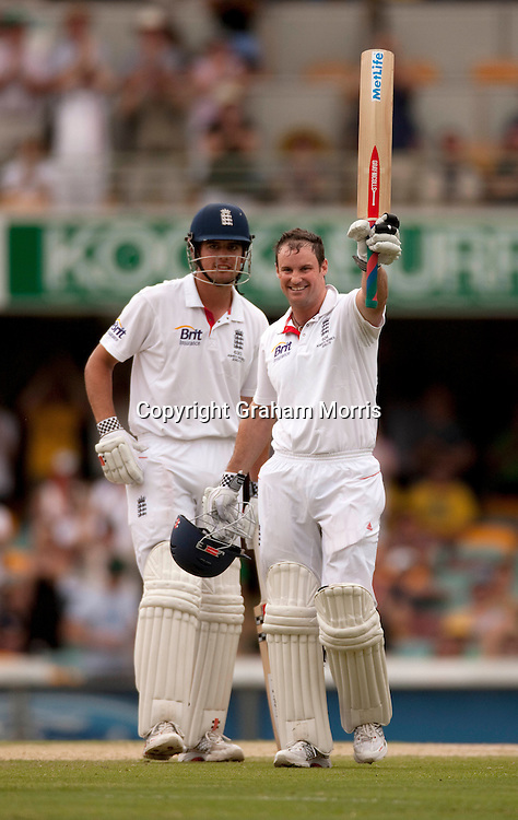 Andrew Strauss (right) celebrates his century with Alastair Cook (who later joined him) during the first Ashes Test Match between Australia and England at the Gabba, Brisbane. Photo: Graham Morris (Tel: +44(0)20 8969 4192 Email: sales@cricketpix.com) 28/11/10