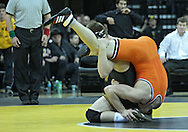 January 07, 2011: Iowa's Ethen Lofthouse and Oklahoma State's Chris Perry during the 174-pound bout in the NCAA wrestling dual between the Oklahoma State Cowboys and the Iowa Hawkeyes at Carver-Hawkeye Arena in Iowa City, Iowa on Saturday, January 7, 2012. Perry won 3-2.