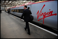 George Osborne Shadow Chancellor of the Exchequer runs to catch a train at   Glasgow Station to Carlisle ,Thursday October 22, 2009 Picture by Andrew Parsons / i-Images