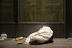 © Licensed to London News Pictures . 07/04/2017 . Manchester , UK . A rough sleeper on Portland Street . Greater Manchester Police have authorised dispersal powers and say they will ban people from the city centre for 48 hours , this evening (7th April 2017) , in order to tackle alcohol and spice abuse . Photo credit : Joel Goodman/LNP