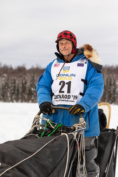 Musher Martin Buser after the restart in Willow of the 47th Iditarod Trail Sled Dog Race in Southcentral Alaska.  Afternoon. Winter.