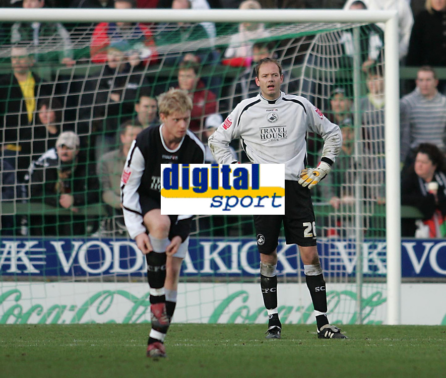 Photo: Lee Earle.<br /> Yeovil Town v Swansea City. Coca Cola League 1. 24/02/2007.Swansea keeper Andy Oakes (R) and Alan Tate look dejected after Yeovil's winning goal.