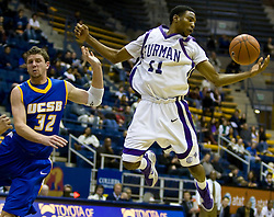 December 28, 2009; Berkeley, CA, USA;  Furman Paladins guard Jordan Miller (11) grabs a rebound in front of UC Santa Barbara Gauchos forward Jon Pastorek (32) during the second half at the Haas Pavilion.  UC Santa Barbara defeated Furman 72-60.