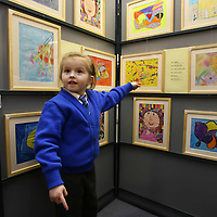 Junior Infants Pupil Evalily Glenane picking out the paintings she likes at the Art Exhibition opening at Flagmount National School on Friday night.<br /> <br /> Photograph by Eamon Ward