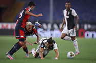 Juventus's Portuguese striker Cristiano Ronaldo is fouled by Genoa's Swiss midfielder Valon Behrami during the Serie A match at Luigi Ferraris, Genoa. Picture date: 30th June 2020. Picture credit should read: Jonathan Moscrop/Sportimage