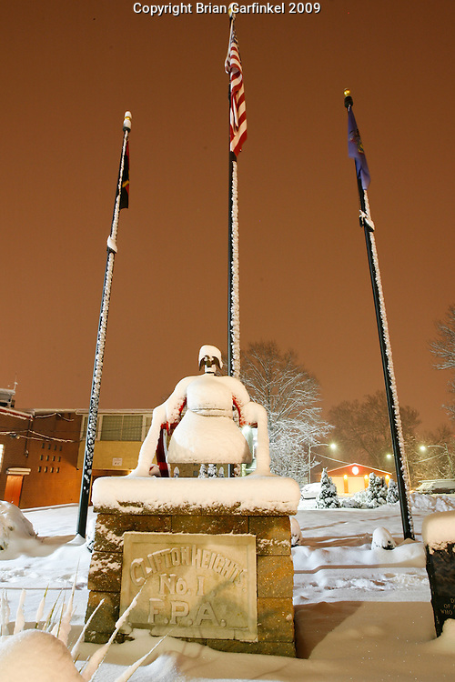 Clifton Heights, Pennsylvania - A snow covered bell is part of a memorial at The Clifton Heights Fire Company a night after a snowfall