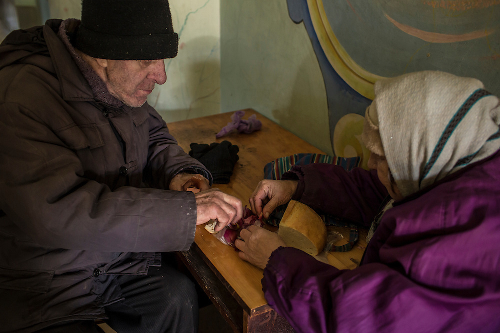 MYRONIVSKYI, UKRAINE - FEBRUARY 17: People eat lunch inside the local House of Culture, which serves as a distribution point for humanitarian aid and provides a bomb shelter, on February 17, 2015 in Myronivskyi, Ukraine. A ceasefire agreed to by Ukraine and pro-Russian rebel forces has failed to prevent fighting in the nearby town of Debaltseve, where thousands of Ukrainian troops remain and whom rebels claim to have surrounded. (Photo by Brendan Hoffman/Getty Images) *** Local Caption ***