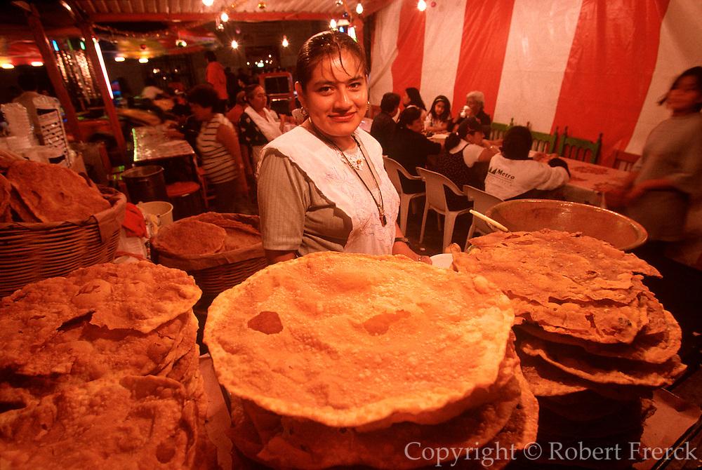MEXICO, FESTIVALS Oaxaca, vendor selling bunelos