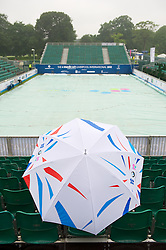 LIVERPOOL, ENGLAND - Thursday, June 21, 2012: A lone spectator waits for play to start as rain delays the opening day of the Medicash Liverpool International Tennis Tournament at Calderstones Park. (Pic by David Rawcliffe/Propaganda)