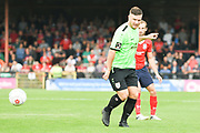 Joe Guest of Curzon Ashton (7) passes the ball forward during the Vanarama National League North match between York City and Curzon Ashton at Bootham Crescent, York, England on 18 August 2018.