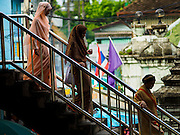 17 JULY 2015 - BANGKOK, THAILAND:     Women walk to Ton Son Mosque in Bangkok for Eid al-Fitr services. Eid al-Fitr is also called Feast of Breaking the Fast, the Sugar Feast, Bayram (Bajram), the Sweet Festival or Hari Raya Puasa and the Lesser Eid. It is an important Muslim religious holiday that marks the end of Ramadan, the Islamic holy month of fasting. Muslims are not allowed to fast on Eid. The holiday celebrates the conclusion of the 29 or 30 days of dawn-to-sunset fasting Muslims do during the month of Ramadan. Islam is the second largest religion in Thailand. Government sources say about 5% of Thais are Muslim, many in the Muslim community say the number is closer to 10%.          PHOTO BY JACK KURTZ