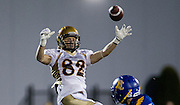 26 August 2016:  Riley Harrison (82) of the Bisons goes up for a reception attempt  in the Vancouver Island Thunder Bowl.  Action during a men's CIS exhibition Football game between the University of British Columbia Thunderbirds and the visiting University of Manitoba Bisons at Westhills Stadium in Langford, BC, Canada. Final Score: Manitoba 50 UBC 7 ****(Photo by Bob Frid/UBC Athletics  2016 - All Rights Reserved****)