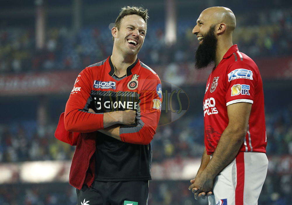AB de Villiers of the Royal Challengers Bangalore chat with Hashim Amla of Kings XI Punjab after the match 8 of the Vivo 2017 Indian Premier League between the Kings X1 Punjab and the Royal Challengers Bangalore held at the Holkar Cricket Stadium in Indore, India on the 10th April 2017<br /> <br /> Photo by Arjun Singh - IPL - Sportzpics
