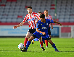 Lincoln City's James Hugo vies for possession with Leicester City's Sim Thandi<br /> <br /> Lincoln City under 18s Vs Leicester City under 18s at Sincil Bank, Lincoln.<br /> <br /> Picture: Chris Vaughan/Chris Vaughan Photography<br /> <br /> Date: July 28, 2016