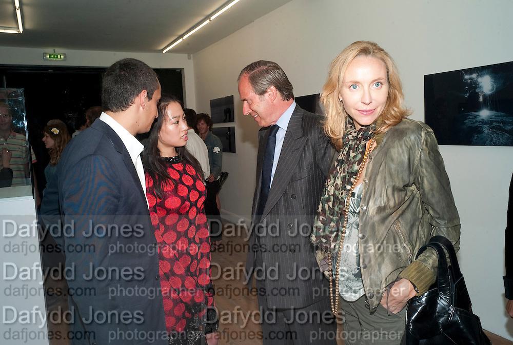 "ALEX DELLAL; YI ZHOU; SIMON DE PURY; MICHAELA DE PURY, Video artist Yi Zhou  first solo show ""I am your Simulacrum"".Exhibition opening at 20 Hoxton Square Projects. Hoxton Sq. London. 1 September 2010.  -DO NOT ARCHIVE-© Copyright Photograph by Dafydd Jones. 248 Clapham Rd. London SW9 0PZ. Tel 0207 820 0771. www.dafjones.com."