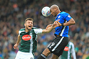 Calvin Andrew wins a header during the EFL Sky Bet League 1 match between Plymouth Argyle and Rochdale at Home Park, Plymouth, England on 28 October 2017. Photo by Daniel Youngs.