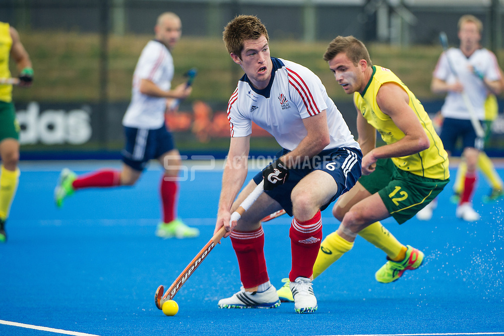 Great Britain's Henry Weir is watched by Jacob Whetton of Australia. Great Britain v Australia, Lee Valley Hockey & Tennis Centre, London, UK on 13 June 2015. Photo: Simon Parker