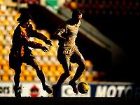 Photo: Jed Wee.<br /> <br /> Bradford City v Bristol City. Coca Cola League 1. 18/02/2006.<br /> <br /> <br /> <br /> Bristol's Dave Cotterill (R) takes on Bradford's Tom Penford.