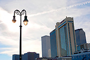 A street lamp against the skyline in New Orleans.