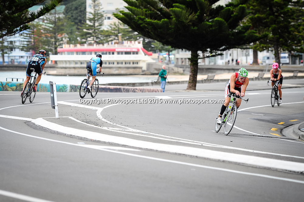 competitors rounds a turn on the bike leg of the Sovereign Tri Series, Waterfront, Wellington, New Zealand. Saturday 14 March 2015. Copyright Photo: Mark Tantrum/www.Photosport.co.nz