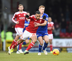 Swindon Town's Louis Thompson challenges Chesterfield's Eoin Doyle in the Sky Bet League One match between Swindon Town and Chesterfield at The County Ground on January 17, 2015 in Swindon, England. - Photo mandatory by-line: Paul Knight/JMP - Mobile: 07966 386802 - 17/01/2015 - SPORT - Football - Swindon - The County Ground - Swindon Town v Chesterfield - Sky Bet League One