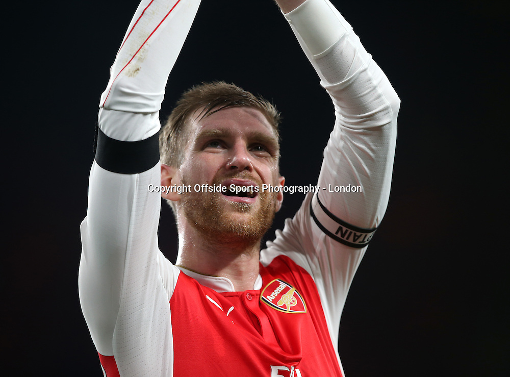 28 December 2015 - Premier League - Arsenal v AFC Bournemouth :<br /> tired looking Arsenal captain Per Mertesacker.<br /> Photo: Mark Leech