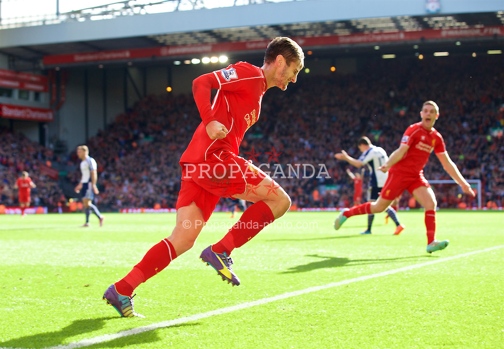 LIVERPOOL, ENGLAND - Saturday, October 4, 2014: Liverpool's Adam Lallana celebrates scoring the first goal against West Bromwich Albion during the Premier League match at Anfield. (Pic by David Rawcliffe/Propaganda)